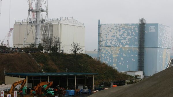 A part of the roof of a building covering the Unit 1 reactor, left, is seen removed at the Fukushima Dai-ichi nuclear power plant in Okuma, Fukushima prefecture, northeastern Japan, Wednesday, Nov. 12, 2014 - Sputnik International