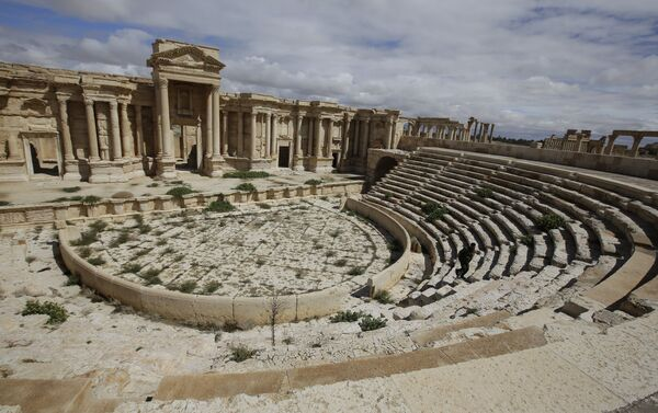 A file picture taken on March 14, 2014 shows a partial view of the theatre at the ancient oasis city of Palmyra, 215 kilometres northeast of Damascus. Islamic State group fighters advanced to the gates of ancient Palmyra on May 14, 2015 - Sputnik International