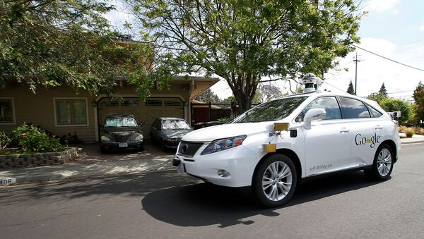 Google's self-driving Lexus car drives along street during a demonstration at Google campus on Wednesday, May 13, 2015, in Mountain View, Calif - Sputnik International