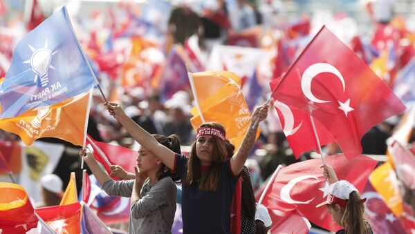 Supporters of Turkey's Prime Minister Ahmet Davutoglu wave Turkish and AK Party flags during an election rally for Turkey's June 7 parliamentary elections in Istanbul, Turkey, May 17, 2015 - Sputnik International