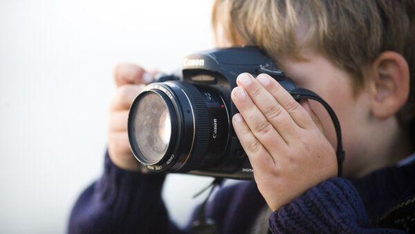 A boy with camera - Sputnik International