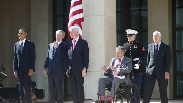 President Barack Obama stands with former presidents George W. Bush, Bill Clinton, George H.W. Bush, and Jimmy Carter. - Sputnik International