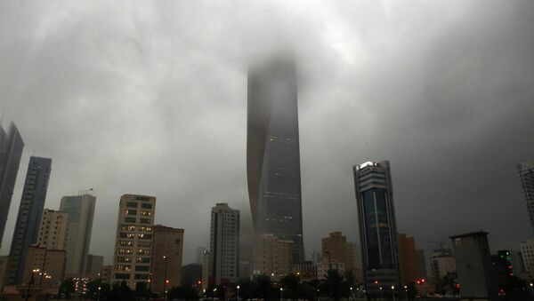 Clouds cover buildings in Kuwait City during a heavy rainfall - Sputnik International
