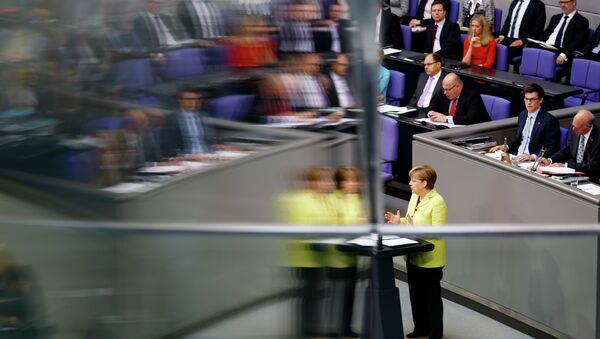 German Chancellor Angela Merkel is reflected in a window pane as she delivers a government declaration about the European Union and an Eastern Partnership with former Soviet Republics at the German parliament Bundestag in Berlin, Germany, Thursday, May 21, 2015. - Sputnik International