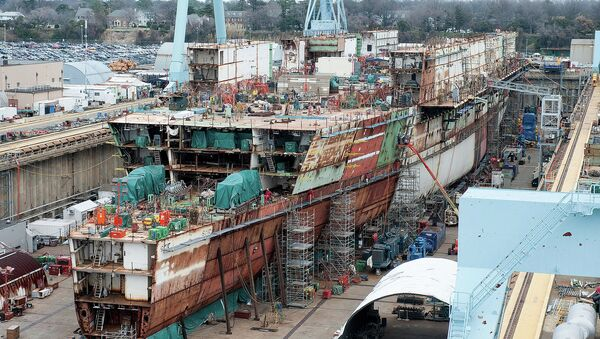 The USS Ford - seen here under construction in 2012 - ran $2 billion over budget but the Navy promised most of those costs were due to its being the first of its class and would not recur with the USS Kennedy. - Sputnik International