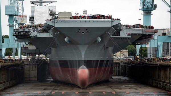 The estimated cost to the US Navy's second Ford-class aircraft carrier is already $370 million above a Congressionally mandated cap set for its construction after the USS Ford - pictured here - ran $2 billion over budget. - Sputnik International