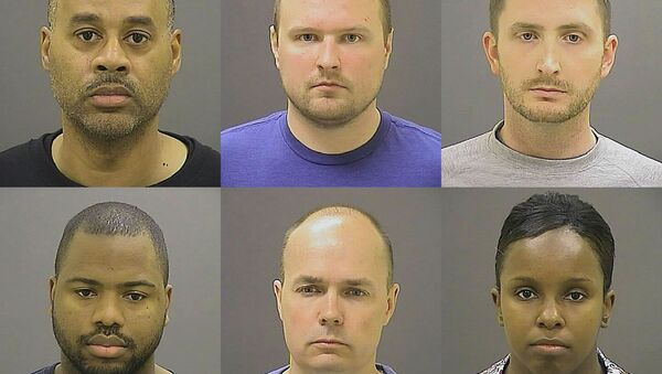 These undated photos provided by the Baltimore Police Department, show Baltimore police officers, top row from left, Caesar R. Goodson Jr., Garrett E. Miller and Edward M. Nero, and bottom row from left, William G. Porter, Brian W. Rice and Alicia D. White, charged with felonies ranging from assault to murder in the police-custody death of Freddie Gray. A grand jury indicted the six officers, State's Attorney Marilyn Mosby said Thursday, May 21, 2015. - Sputnik International