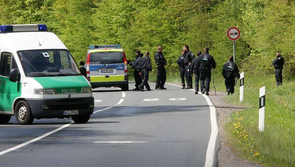 German police officers search for evidence in a forest near Oberursel, Germany, Thursday, April 30, 2015 - Sputnik International
