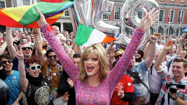 Rory O'Neill, known by the Drag persona Panti, celebrates with yes supporters at Dublin Castle, Ireland, Saturday, May 23, 2015. Ireland has voted resoundingly to legalize gay marriage in the world's first national vote on the issue, leaders on both sides of the Irish referendum declared Saturday even as official ballot counting continued. Senior figures from the no campaign, who sought to prevent Ireland's constitution from being amended to permit same-sex marriages, say the only question is how large the yes side's margin of victory will be from Friday's vote. - Sputnik International