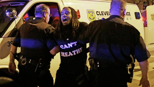 A protester is arrested after the acquittal of Michael Brelo, a patrolman charged in the shooting deaths of two unarmed suspects Saturday, May 23, 2015, in Cleveland - Sputnik International