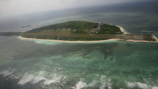An aerial photo shows Thitu Island, part of the disputed Spratly group of islands, in the South China Sea located off the coast of western Philippines on July 20, 2011 - Sputnik International