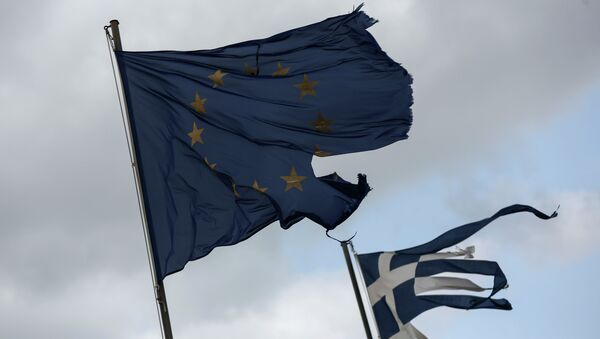Ruined EU and Greek flags fly in tatters from a flag pole at a beach at Anavissos village, southwest of Athens, on Monday, March 16, 2015 - Sputnik International
