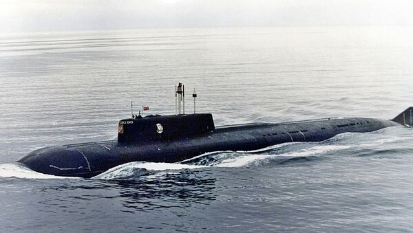 The Kursk, one of Russia's largest and most advanced submarines, which exploded and sank during naval maneuvers in August 2000, heaves ahead in the Barents Sea near Severomorsk in this 1999 file photo - Sputnik International