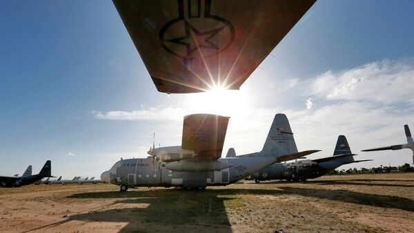 Numerous C-130 cargo planes are lined up in a field at the 309th Aerospace Maintenance and Regeneration Group boneyard at Davis-Monthan Air Force Base in Tucson, Ariz - Sputnik International