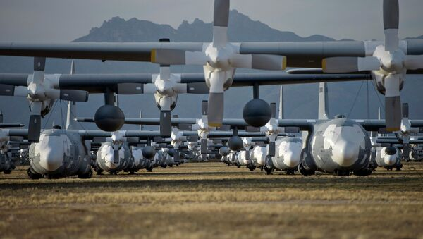 C-130 Hercules cargo planes are lined up in a field at the 309th Aerospace Maintenance and Regeneration Group boneyard at Davis-Monthan Air Force Base in Tucson, Ariz - Sputnik International