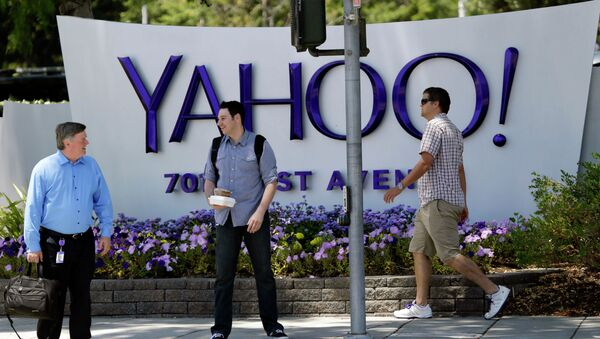 People walk in front of a Yahoo sign at the company's headquarters in Sunnyvale, California. - Sputnik International