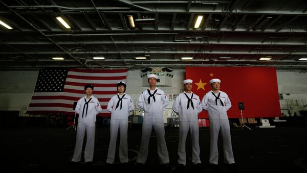 Chinese-American Navy sailors stand in front of the China's and American national flags on the aircraft carrier USS George Washington. - Sputnik International