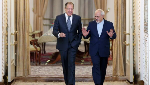 Iranian Foreign Minister Mohammad Javad Zarif, right, and his Russian counterpart Sergey Lavrov arrive to their joint press conference in Tehran, Iran - Sputnik International