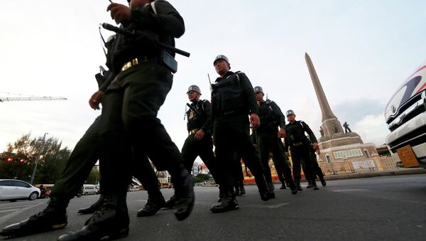 Thai military police officers march while guarding to prevent anti-coup demonstration at Victory Monument - Sputnik International