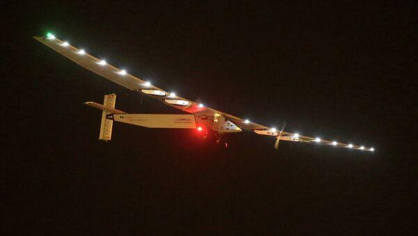 Solar Impulse 2 is seen prior landing at the Nanjing Lukou International Airport in Nanjing, east China's Jiangsu province, on April 21, 2015 - Sputnik International
