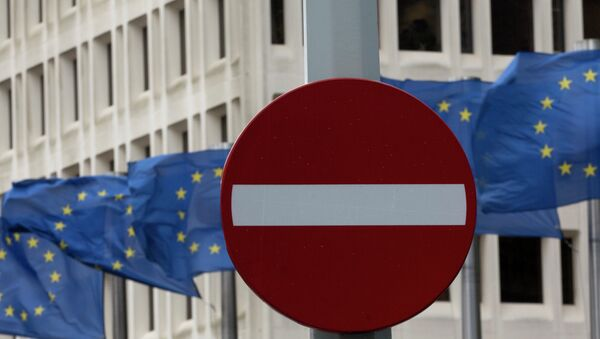 In this photo taken on Monday, March 30, 2015 EU flags flap in the wind behind a no entry traffic sign in front of EU headquarters in Brussels - Sputnik International