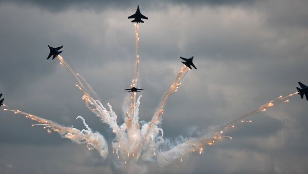 The Russkiye Vityazy (Russian Knights) aerobatic team performs in Sukhoi 27 jets at the Russian stage of the Aviadarts-2015 Flight Skills Competition in Voronezh - Sputnik International