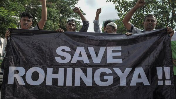 Ethnic Rohingya refugees from Myanmar residing in Malaysia hold a banner during a protest outside the Myanmar embassy in Kuala Lumpur on May 21, 2015 - Sputnik International
