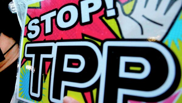A placard during a rally against the Trans-Pacific Partnership (TPP) - Sputnik International