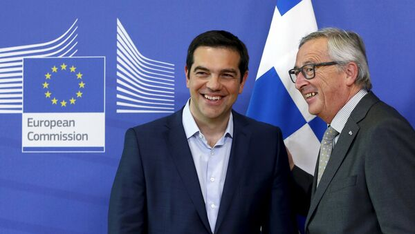 Greek Prime Minister Alexis Tsipras is welcomed by European Commission President Jean-Claude Juncker (R) ahead of a meeting at the EU Commission headquarters in Brussels, Belgium, June 3, 2015 - Sputnik International