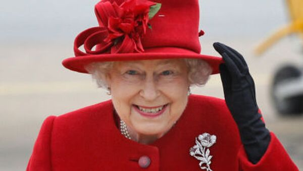 Britain's Queen Elizabeth II holds on to her hat in high winds as she arrives for a visit to RAF Valley, Anglesey, Wales, where her grandson Prince William, is stationed as a search and rescue helicopter pilot Friday April 1, 2011 - Sputnik International