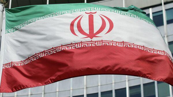 The Iranian flag flies in front of a UN building. - Sputnik International