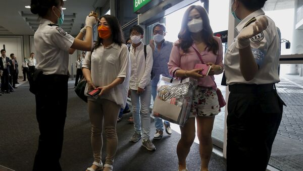 Flight passengers from Busan - Sputnik International