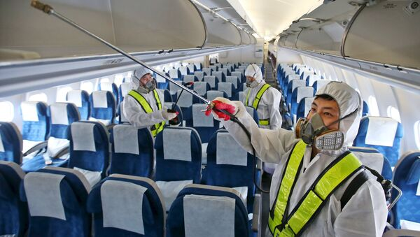 Employees from Korean Air disinfect the interior of its airplane in Incheon, South Korea, June 5, 2015 - Sputnik International