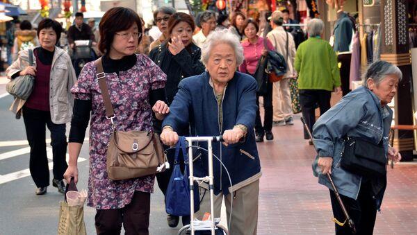 Elderly people stroll down a shopping precinct in Tokyo on October 28, 2011 - Sputnik International