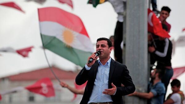 Selahattin Demirtas, co-chair of the pro-Kurdish Peoples' Democratic Party (HDP), delivers a speech from the top of his election campaign bus at a rally in Istanbul, Turkey, Saturday, June 6, 2015. - Sputnik International
