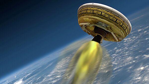 An undated artist's concept shows the test vehicle for NASA's Low-Density Supersonic Decelerator (LDSD), designed to test landing technologies for future Mars missions - Sputnik International