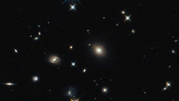 The image shows the foreground lensing galaxy (observed with Hubble), and the gravitationally lensed galaxy SDP.81, which forms an almost perfect Einstein Ring, is hardly visible. - Sputnik International