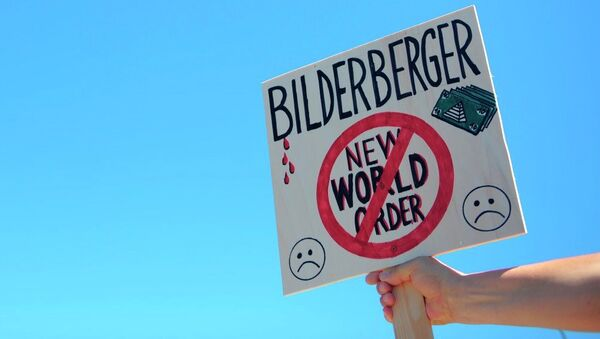 An activist protests near the meeting place for the conference of the Bilderberg Group - Sputnik International