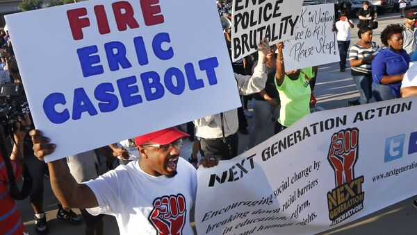 Protestors march Monday, June 8, 2015, during a demonstration in response to an incident at a community pool involving McKinney police officers. - Sputnik International
