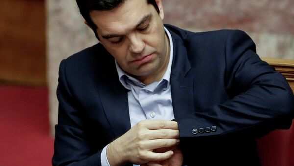 Greece's Prime Minister Alexis Tsipras looks at his watch during a parliament session in Athens, - Sputnik International