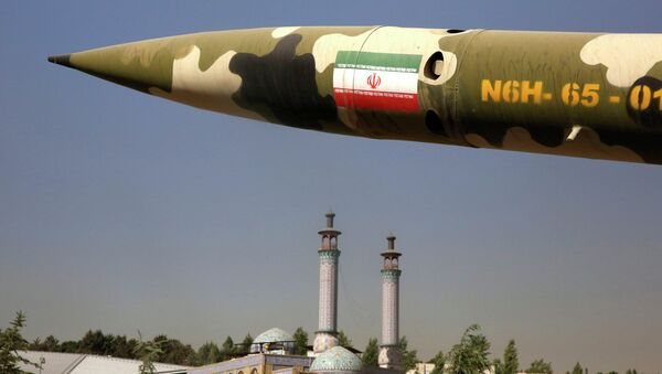 A missile is displayed at an exhibition on the 1980-88 Iran-Iraq war, at a park, northern Tehran, Iran, Thursday, Sept. 25, 2014 - Sputnik International
