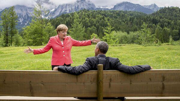 German Chancellor Angela Merkel speaks with U.S. President Barack Obama outside the Elmau castle in Kruen near Garmisch-Partenkirchen, Germany, June 8, 2015. - Sputnik International