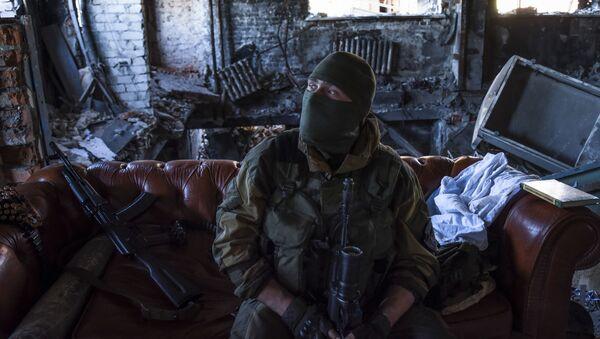 Donbass militiaman rests at his position inside the Donetsk airport, eastern Ukraine. June 9, 2015. - Sputnik International