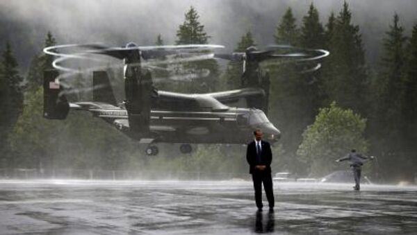 US Marine Osprey sends up a big wash of rain as as it lands near the Bavarian town of Kruen, Germany, June 8, 2015. The Ospreys provided transport to Air Force One in Munich for members of U.S. President Barack Obama's staff, Secret Service, White House Press Corps and other personnel at the conclusion of the G7 Summit - Sputnik International