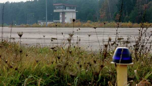 The overgrown runway of an airstrip used by the CIA to covertly bring detainees into Poland. - Sputnik International