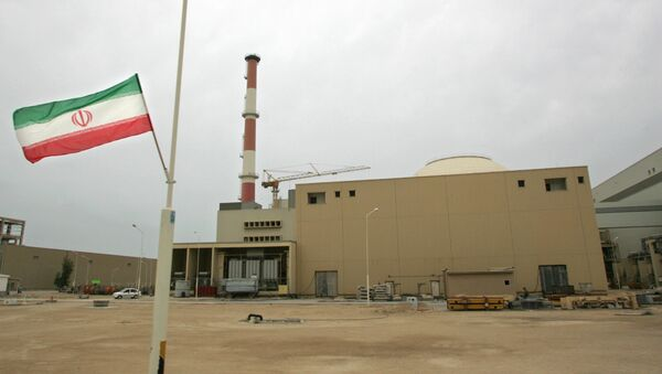 Iranian flag outside the building housing the reactor of the Bushehr nuclear power plant. (File) - Sputnik International