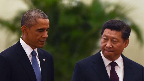 US President Barack Obama (L) walks with Chinese President Xi Jinping - Sputnik International