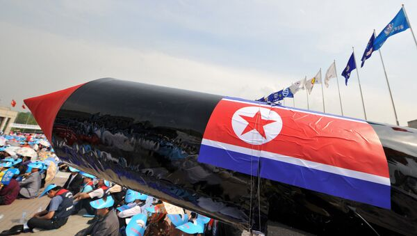 A mock North Korean missile is pictured during a rally denouncing North Korea's nuclear test and its recent missile launches, at the War Memorial of Korea in Seoul - Sputnik International