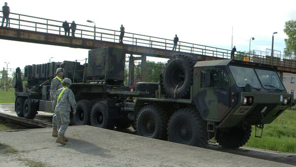 Soldiers watch a US Patriot missile being unloaded in a Polish Army military unit in Morag, northern Poland. File photo. - Sputnik International
