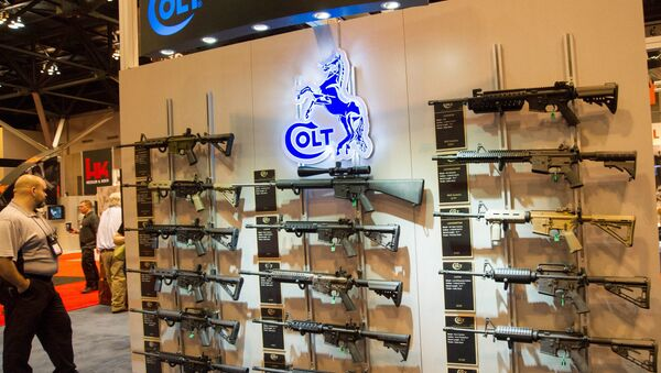 A wall of Colt M4 Carbines in various configurations are displayed at the National Rifle Association (NRA) Annual Meetings and Exhibits on April 14, 2012 in St. Louis, Missouri - Sputnik International